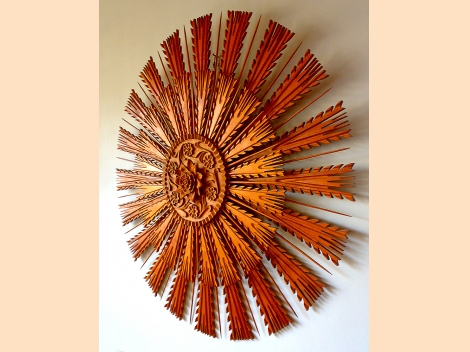 Wood-carved sun-shaped rosette for ceiling or wall decoration