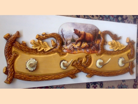 Hanger, wood-carving with a painting of a bear in a mountain